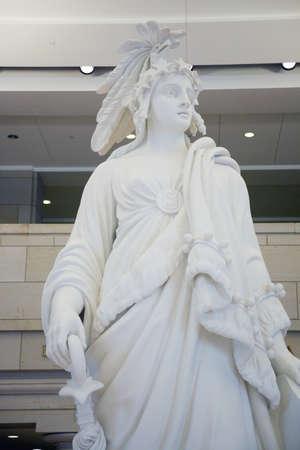 u s: Students visiting U.S. Capitol look down on statue of Statue of Freedom at the U.S. Capitol Visitors Center, Washington, D.C.