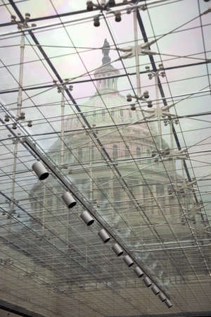 U.S. Capitol through glass windows at the U.S. Capitol Visitors Center, Washington, D.C.