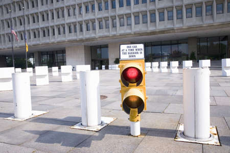 Security barriers warn drivers of risk in front of Federal Building, Washington D.C. Editorial