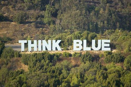 dodgers: Think Blue sign for LA Dodgers in Chavez Ravine near Dodger Stadium, Los Angeles, CA
