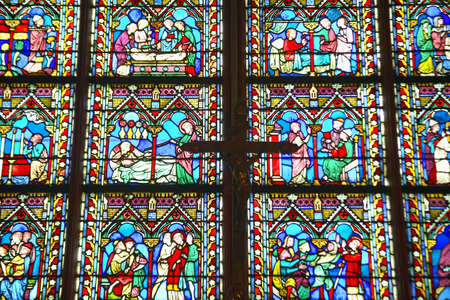 glasswork: Stained glass windows inside the Notre Dame Cathedral, Paris, France