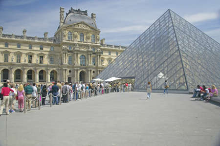 sightseers: Exterior of the Louvre Museum, Paris, France