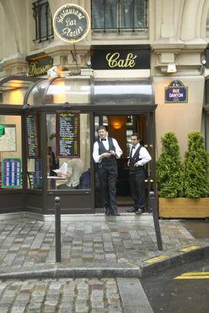 Waiters outside Paris CafŽ, Paris, France