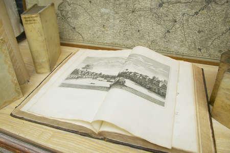 merchant: Antique book in shop window, Paris, France