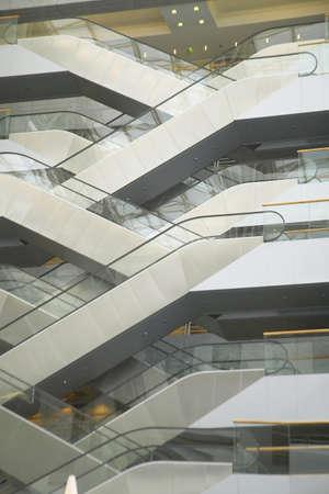 Escalators in the interior of office building, Paris, France Sajtókép
