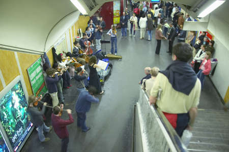 subterranean: Orchestra musicians playing in Metro Station, Paris, France
