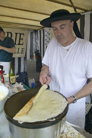 Crepe Stand with man making crepe at the Flea Market, Paris, France Editorial