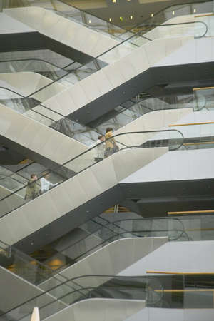 Escalators in the interior of office building, Paris, France Sajtókép