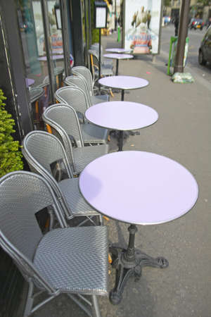 caf: Empty tables at outdoor caf�, Paris, France