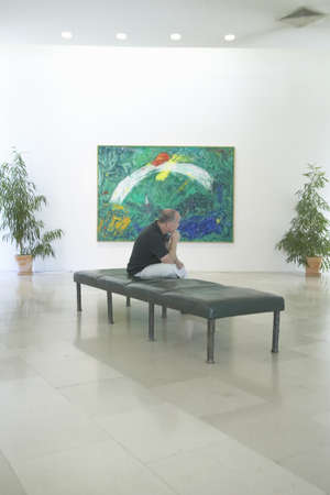 marc: Tourist looks at paintings by Marc Chagall, Marc Chagall Museum, Nice, France Editorial