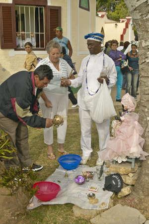 religion catolica: Iglesia San L�zaro cat�lica con la santer�a ofrece servicios sacerdote en El Rincon, Cuba Editorial