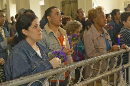 San Lazaro Catholic Church and people praying in El Rincon, Cuba Editoriali