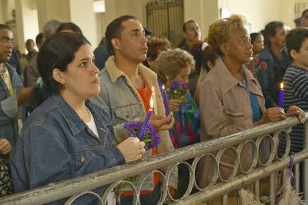 San Lazaro Catholic Church and people praying in El Rincon, Cuba