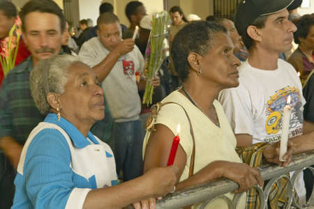 procession: San Lazaro Catholic Church and people praying in El Rincon, Cuba Editorial