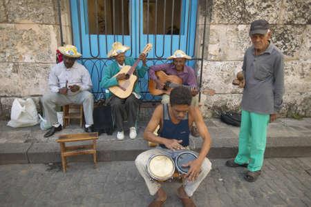 Cuba musicians playing music on streets at Catedral de la Habana, Plaza del Catedral, Old Havana, Cuba