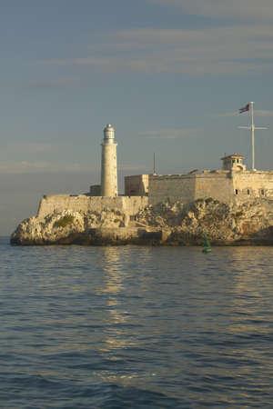 indies: Lighthouse at Castillo del Morro, El Morro Fort, across the Havana channel, Cuba Stock Photo