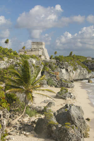 roo: Mayan ruins of Ruinas de Tulum (Tulum Ruins) in Quintana Roo, Mexico. El Castillo is pictured in Mayan ruin in the Yucatan Peninsula, Mexico at sunset, with beach and Caribbean Sea to right