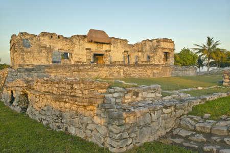 roo: Mayan ruins of Ruinas de Tulum (Tulum Ruins) in Quintana Roo, Mexico in the Yucatan Peninsula, Mexico at sunset Stock Photo