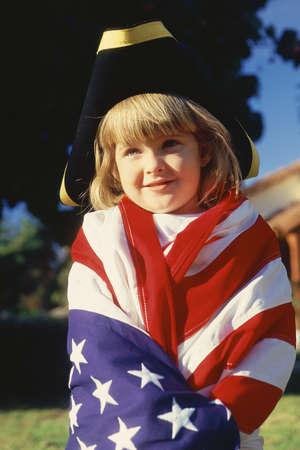 three cornered: Little girl wrapped in American flag wearing three cornered hat