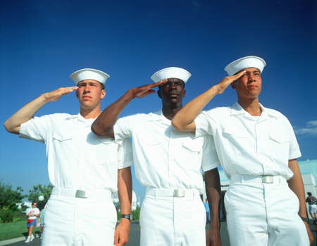 Ethnically diverse trio of sailors saluting Editorial