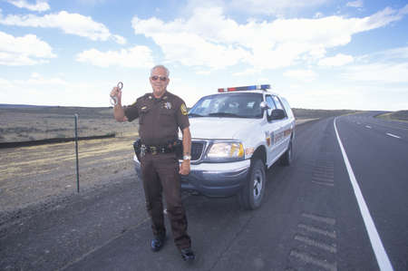 sheriffs: County sheriff with handcuffs, New Mexico Editorial