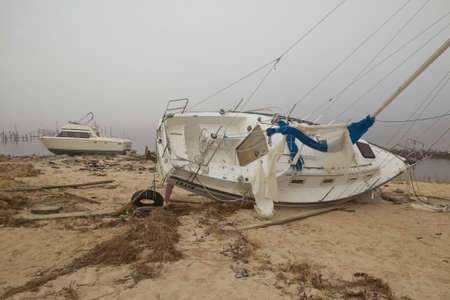 Overturned sailboat in wake of Hurricane Ivan in Pensacola Florida