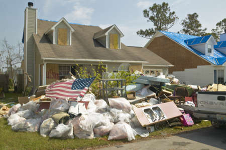 American flag and debris in front of house heavily hit by Hurricane Ivan in Pensacola Florida