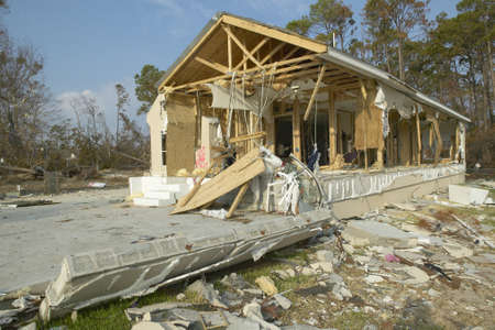 Debris in front of house heavily hit by Hurricane Ivan in Pensacola Florida