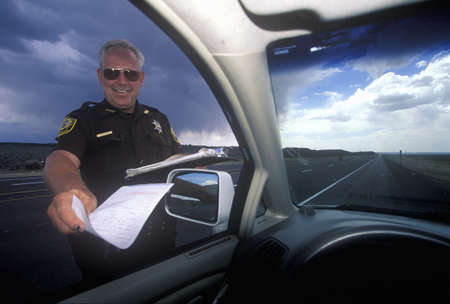 County sheriff giving speeding ticket in North New Mexico