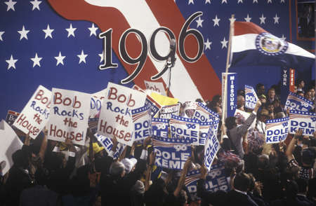 delegates: Enthusiastic delegates wave their signs supporting Bob Dole and Jack Kemp at the 1996 Republican National Convention in San Diego, California Editorial