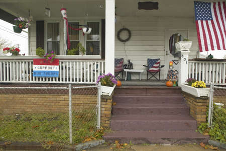 middle america: A rural house with American flag and We Support Our Troops sign in Ohio Editorial
