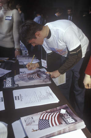 primaries: Student filling out a Youth for Bush sign-up sheet at the New Hampshire Presidential Candidates Youth Forum, January 2000 Editorial