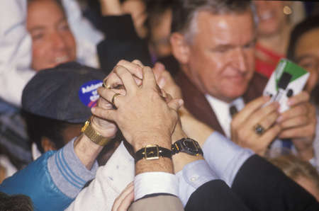 campaigning: Hands join for Governor Bill Clinton during a Denver campaign rally in 1992 on his final day of campaigning in Denver, Colorado Editorial