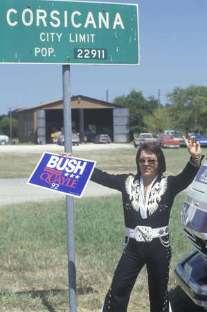 campaigning: Elvis look alike holds a BushQuayle sign during the ClintonGore 1992 Buscapade campaign tour in Corsicana, Texas