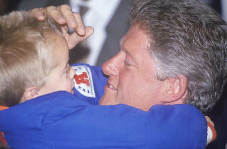 campaigning: Governor Bill Clinton embraces a child at a Denver campaign rally in 1992 on his final day of campaigning in Denver, Colorado Editorial