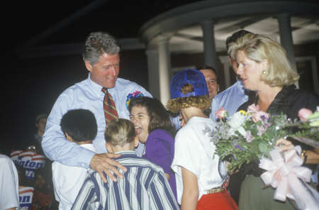 Governor Bill Clinton embraces a group of children at Tyler Junior College on the ClintonGore 1992 Buscapade campaign tour in Tyler, Texas Editorial