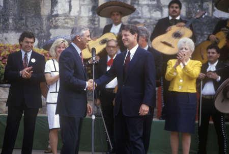 Senator Al Gore shakes hands with Senator Lloyd Bentsen at Arneson River during the Clinton/Gore 1992 Buscapade campaign tour in San Antonio, Texas