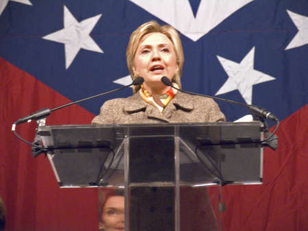 Sen. Hillary Clinton (D-NY), wife of former U. S. Former President Bill Clinton, speaks at a Little Rock, AK luncheon honoring the First Ladies of the state in front of the state flag November 17, 2004 in Little Rock, AK