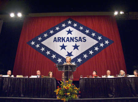 u s: Sen. Hillary Clinton (D-NY), wife of former U. S. Former President Bill Clinton, speaks at a Little Rock, AK luncheon honoring the First Ladies of the state in front of the state flag November 17, 2004 in Little Rock, AK