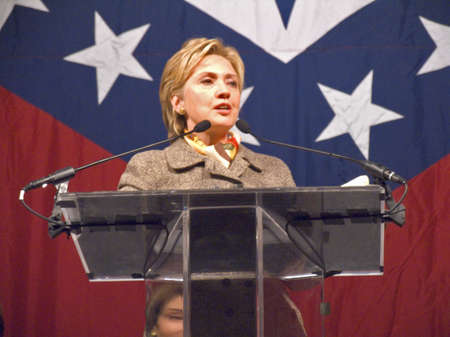 sen: Sen. Hillary Clinton (D-NY), wife of former U. S. Former President Bill Clinton, speaks at a Little Rock, AK luncheon honoring the First Ladies of the state in front of the state flag November 17, 2004 in Little Rock, AK