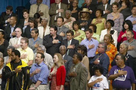 reciting: Multi-cultural crowd reciting Pledge of Allegiance at Kerry Campaign rally, CSU- Dominguez Hills, Los  Angeles, CA Editorial
