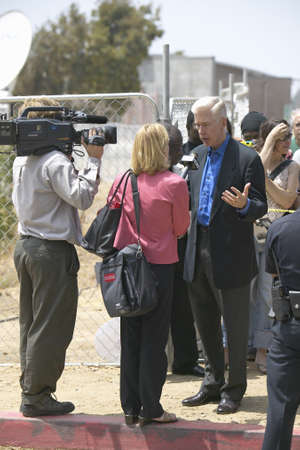 governor: Former Governor Gray Davis being interviewed by newscaster and cameraman, CSU- Dominguez Hills, Los  Angeles, CA