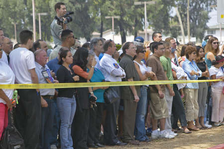 campaigning: Crowd of people outside behind yellow police ribbon, CSU- Dominguez Hills, Los  Angeles, CA