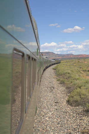 across america: Whistle Stop Kerry Express across America train moving through landscape, American Southwest