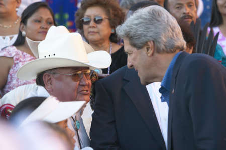 83rd: Senator John Kerry interacts with audience member of 83rd Intertribal Indian Ceremony, Gallup, NM Editorial