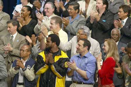 campaigning: Audience clapping for Senator John Kerry at major policy address on the economy, CSU- Dominguez Hills, Los  Angeles, CA Editorial