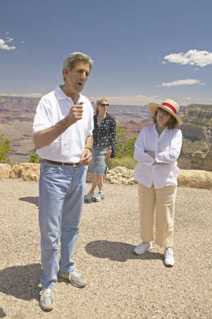 senator: Senator John Kerry, with family,  speaking at rim of Bright Angel Lookout, Grand Canyon, AZ Editorial