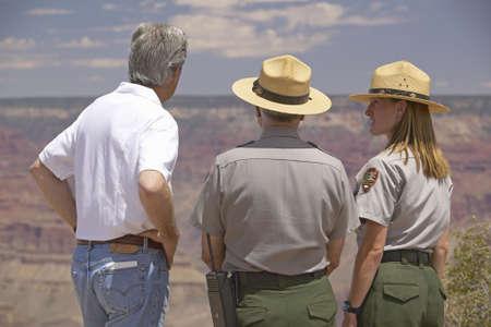 senator: Senator John Kerry speaking with 2 rangers at rim of Bright Angel Lookout, Grand Canyon, AZ