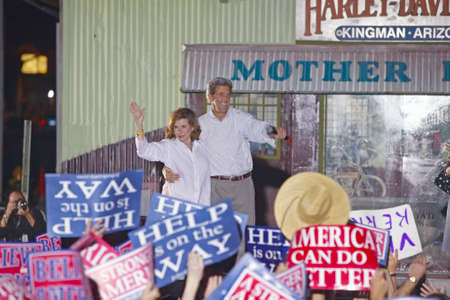 campaigning: Senator and Mrs. John Kerry waving from stage at outdoor Kerry Campaign rally, Kingman, AZ