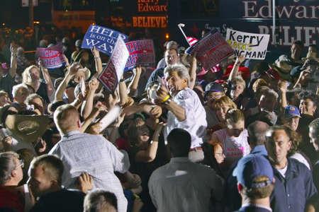 senator: Senator John Kerry interacting with crowd at outdoor Kerry Campaign rally, Kingman, AZ Editorial
